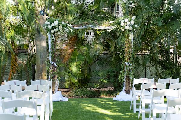 St Petersburg Florida - Special Moments Event Planning - Garden wedding ceremony- outdoor wedding ceremony - wedding arch with crystal chandelier - St Petersburg wedding planner