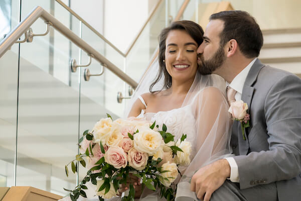 Clearwater Beach wedding - Wyndham Grand Clearwater Beach - blush wedding - blush bridal bouquet- bride and groom on stairs- first look