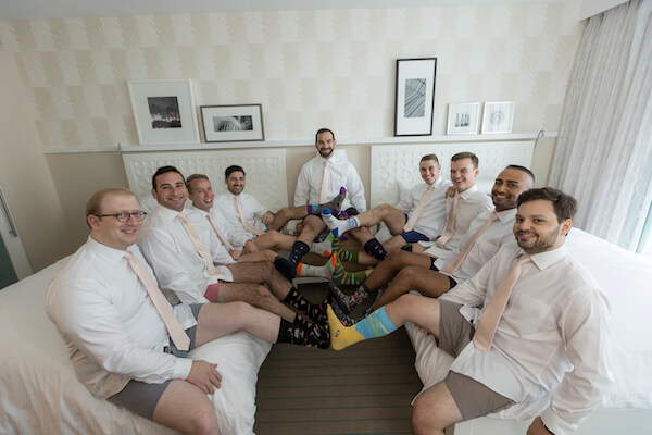 Clearwater Beach wedding - Wyndham Grand Clearwater Beach - Wyndham Grand wedding- groom with groomsmen - groom and groomsmen in fun socks