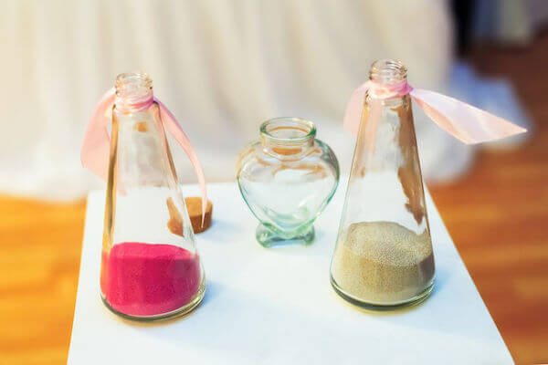 wedding ceremony - beach wedding ceremony. - sand ceremony - unique ideas for a wedding ceremony - heart shaped vase for a sand ceremony - two colors of sand for a sand ceremony
