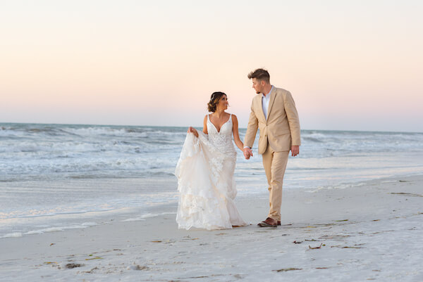Clearwater Beach Wedding. - Sandpearl wedding - Special Moments Event Planning - Clearwater wedding planner- bride and groom walking on beach at sunset
