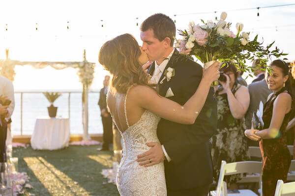 Clearwater Beach Wedding – Opal Sands Wedding – Special Moments Event Planning - just married - first kiss- sunset wedding ceremony - beachfront wedding ceremony - waterfront wedding ceremony