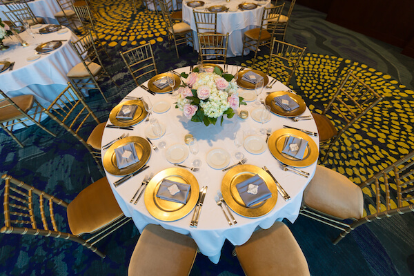 Clearwater Beach Wedding – Opal Sands Wedding – Special Moments Event Planning - gold chivari chairs- gold charger plates- pink and white centerpieces