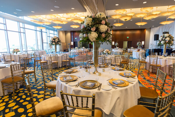 Clearwater Beach Wedding – Opal Sands Wedding – Special Moments Event Planning - gold chivari chairs- gold charger plates - pink and white centerpieces - Opal Sands wedding reception