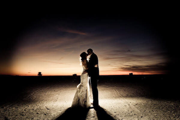 Clearwater Beach Wedding – Opal Sands Wedding – Special Moments Event Planning - bride and groom kissing - bride and groom on beach - sunset kiss on Clearwater Beach