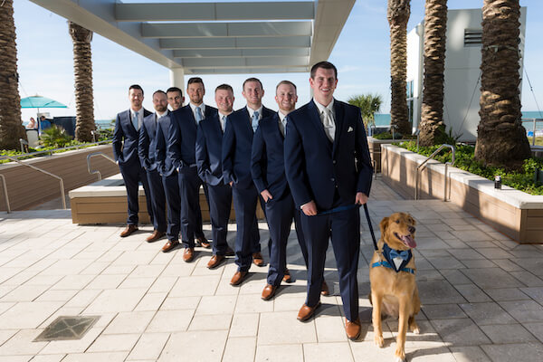 Clearwater Beach Wedding – Opal Sands Wedding – Special Moments Event Planning - groom - wedding party- groom with groomsmen - wedding party in Navy blue suits- groom with dog- including a dog in your wedding - dog with navy blue suit - wedding party with dog