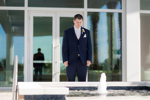 Clearwater Beach Wedding – Opal Sands Wedding – Special Moments Event Planning - groom- groom in blue suit- groom waiting for bride- first look