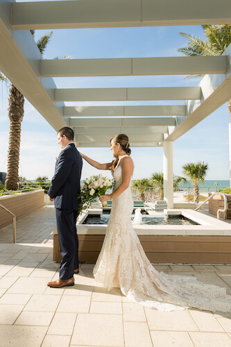 Clearwater Beach Wedding – Opal Sands Wedding – Special Moments Event Planning - first look - bride walking up behind groom