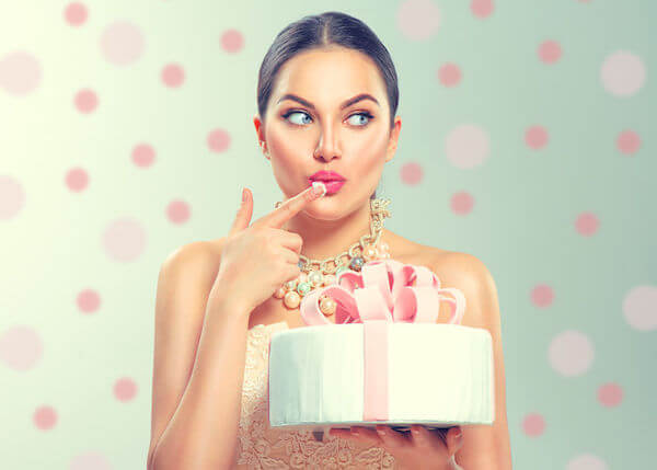 Wedding Planning Advice - when to cut your wedding cake - bride tasting wedding cake - enjoying your wedding cake
