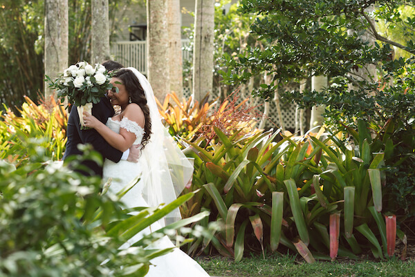 First Look – Bradenton wedding – Palma Sola Botanical Park wedding – Special Moments Event Planning - bride and groom embracing