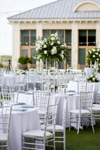 Sandpearl Resort – Sandpearl Wedding – Clearwater Beach Wedding – Greek wedding – Clearwater Beach wedding planner – Special Moments Event Planning - outdoor wedding reception - white dance floor - silver and white wedding - outdoor wedding reception at the Sandpearl Resort - silver chivari chairs