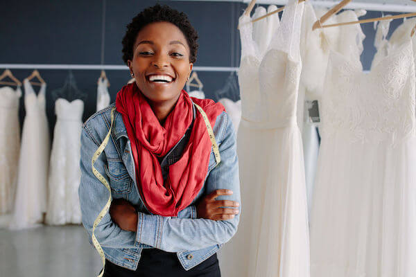 wedding dress alterations - tips for picking the perfect wedding gown - seamstress at a bridal salon
