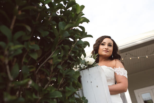 First Look – Bradenton wedding – Palma Sola Botanical Park wedding – Special Moments Event Planning - bride looking at wedding ceremony - bride getting ready to walk down the aisle