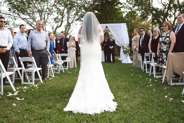 First Look – Bradenton wedding – Palma Sola Botanical Park wedding – Special Moments Event Planning - groom looking at bride walking down the aisle – bride walking down the aisle