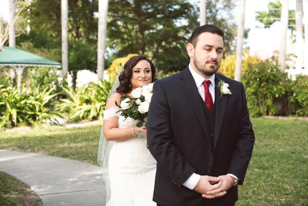 First Look – Bradenton wedding – Palma Sola Botanical Park wedding – Special Moments Event Planning - bride walking up behind groom