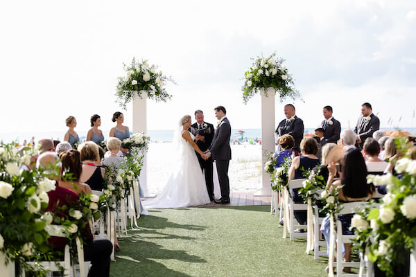 Sandpearl Resort – Sandpearl Wedding – Clearwater Beach Wedding – Greek wedding – Clearwater Beach wedding planner – Special Moments Event Planning - bride and groom - exchanging wedding vows - outdoor wedding ceremony at the Sandpearl resort