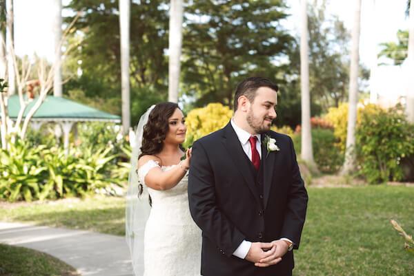 First Look – Bradenton wedding – Palma Sola Botanical Park wedding – Special Moments Event Planning - bride walking up behind groom - bride tapping groom on shoulder