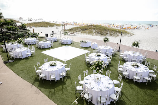 Sandpearl Resort – Sandpearl Wedding – Clearwater Beach Wedding – Greek wedding – Clearwater Beach wedding planner – Special Moments Event Planning - outdoor wedding reception - white dance floor - silver and white wedding - outdoor wedding reception at the Sandpearl Resort