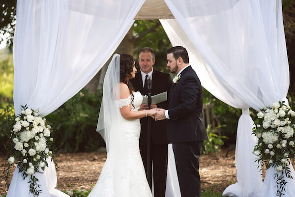 Bradenton wedding – Palma Sola Botanical Park wedding - Special Moments Event Planning - bride - groom - bride and groom exchanging wedding vows- chuppah