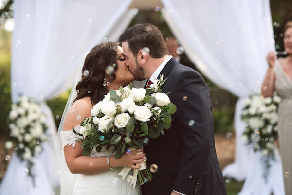 Bradenton wedding – Palma Sola Botanical Park wedding - Special Moments Event Planning - bride - groom - bride with white bouquet - first kiss - just married