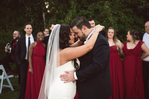 Bradenton wedding – Palma Sola Botanical Park wedding - Special Moments Event Planning -bride and groom - first dance - wedding party watching first dance