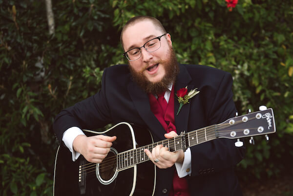 Bradenton wedding – Palma Sola Botanical Park wedding - Special Moments Event Planning - bride's brother paying guitar and singing for their first dance - man of honor -