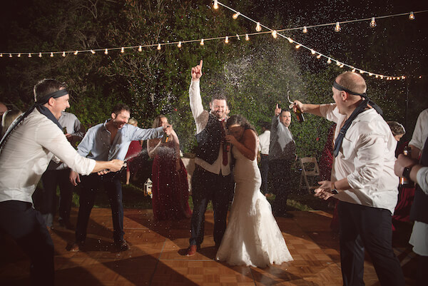 Bradenton wedding – Palma Sola Botanical Park wedding - Special Moments Event Planning - grand exit - champagne grand exit - glow sticks for grand exit