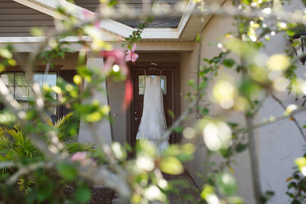 Bradenton wedding – Palma Sola Botanical Park wedding- Special Moments Event Planning - brides gown hung outside of her home - wedding gown