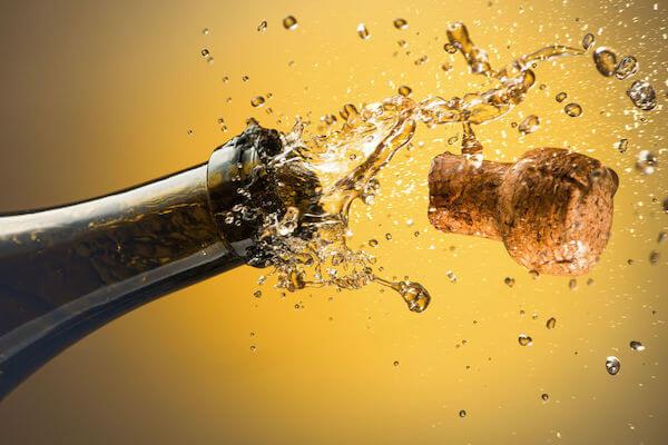 time to celebrate - wedding planning. - Tampa weddings - Tampa wedding planner - celebrations - popping a champagne cork
