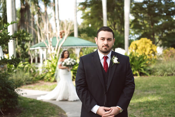Bradenton wedding – Palma Sola Botanical Park wedding - Special Moments Event Planning - bride - groom - bride waling up behind groom - first look