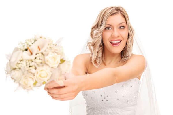 bouquet toss - wedding reception- planning a wedding reception - bride tossing the bouquet