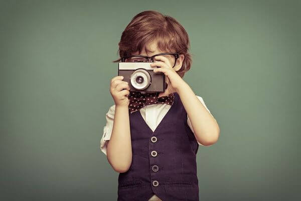 boy with camera at a wedding - including children in your wedding