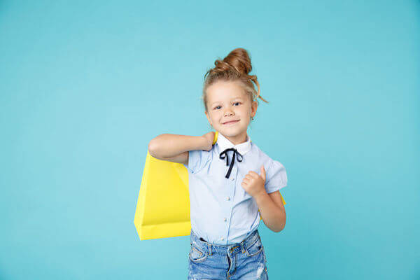 little girl at a wedding with an age appropru=iate activity bag - including children in your wedding