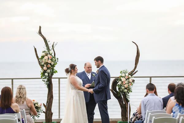 Opal Sands Resort - Opal Sands wedding - Clearwater Beach outdoor wedding - driftwood ceremony structure - bridee and groom exchanging wedding vows