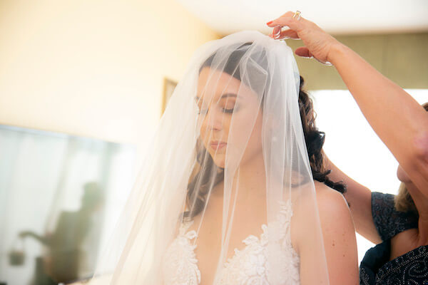 Clearwater Beach Wedding - Holiday inn and Suite Clearwater beach - Special Moments Event Planning - bride - bride finishing dressing. - putting on the bride's veil