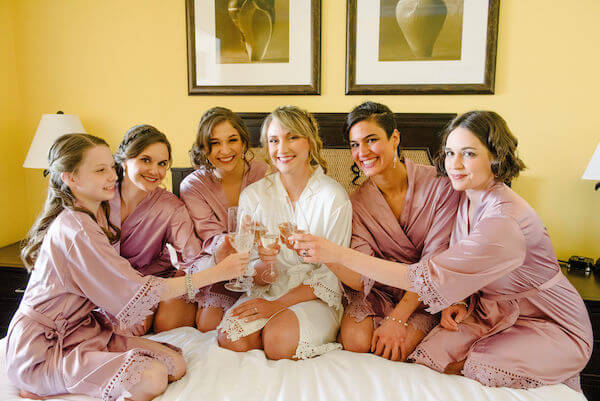 Special moments Event Planning x- Clearwater Beach wedding - Clearwater Beach wedding planner - Sandpearl Resort wedding - bride and bridal party - bride and bridal party in robes - bride and bridal party sipping champagne
