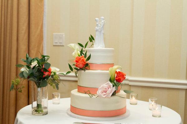 white wedding cake with peach ribbon - three tiered wedding cake - throw away bouquet - anniversary dance