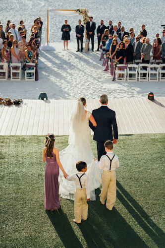Special moments Event Planning x- Clearwater Beach wedding - Clearwater Beach wedding planner - Sandpearl Resort wedding - bride walking down the aisle - bride with father and ring bearers