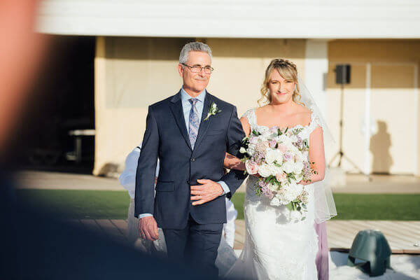 Special moments Event Planning x- Clearwater Beach wedding - Clearwater Beach wedding planner - Sandpearl Resort wedding - bride walking down the aisle with father