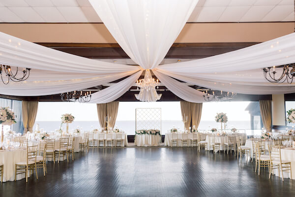 pelican Restaurant wedding - Rusty Pelican Restaurant wedding reception - ballroom with draped ceiling - ceiling drop with twinkle lights- gold and white wedding reception