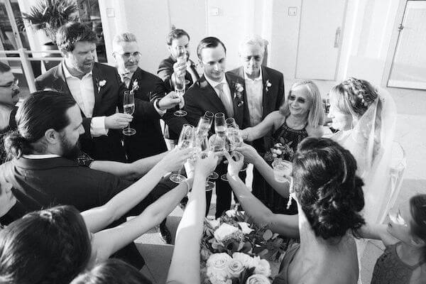 Special moments Event Planning x- Clearwater Beach wedding - Clearwater Beach wedding planner - Sandpearl Resort wedding - bride and groom toast with wedding party