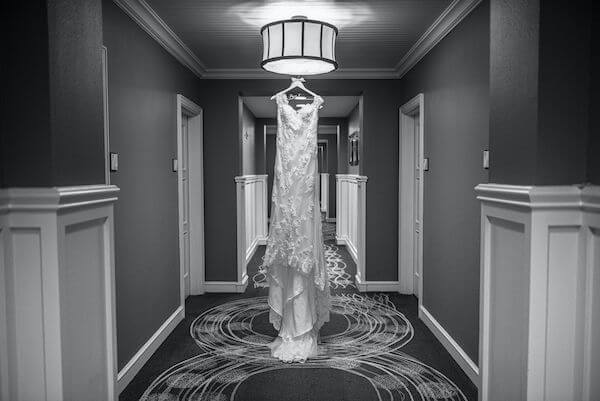 Special moments Event Planning x- Clearwater Beach wedding - Clearwater Beach wedding planner - Sandpearl Resort wedding - lace wedding gown - lace wedding gown photographer hanging in the hotel hallway