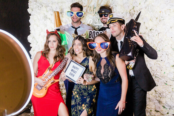 Tampa wedding - Tampa wedding reception - Rusty Pelican Restaurant wedding reception - Photo Booth- wedding guest in photo both with props