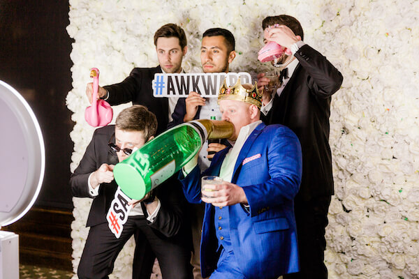 Tampa wedding - Tampa wedding reception - Rusty Pelican Restaurant wedding reception - wedding guests in photo booth with props