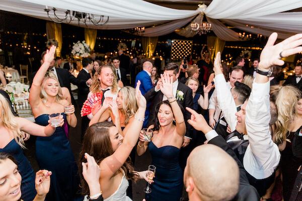 Tampa wedding - Tampa wedding reception - Rusty Pelican Restaurant wedding reception - bride and groom on dance floor- full dance floor at wedding reception