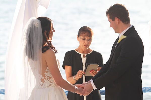 Clearwater Beach Wedding - Holiday inn and Suite Clearwater beach - Special Moments Event Planning - outdoor wedding ceremony - waterfront wedding ceremony. - bride - groom - bride and groom - bride and groom exchanging wedding vows