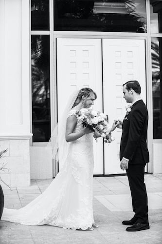 Special moments Event Planning x- Clearwater Beach wedding - Clearwater Beach wedding planner - Sandpearl Resort wedding - black and white photo of bride and groom's first look - bride and groom