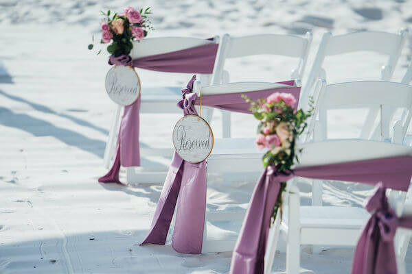 Special moments Event Planning x- Clearwater Beach wedding - Clearwater Beach wedding planner - Sandpearl Resort wedding - ceremony chairs with purple smashes - ceremony chairs with reserved signs - ceremony chairs with purple flowers