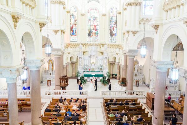 Tampa wedding - Tampa wedding ceremony - Sacred Heart Catholic Church Tampa - wedding ceremony at Sacred heart Catholic Church Tampa - bride and groom - bride and groom exchanging wedding vows - bride and groom exchanging wedding vows in Catholic Church