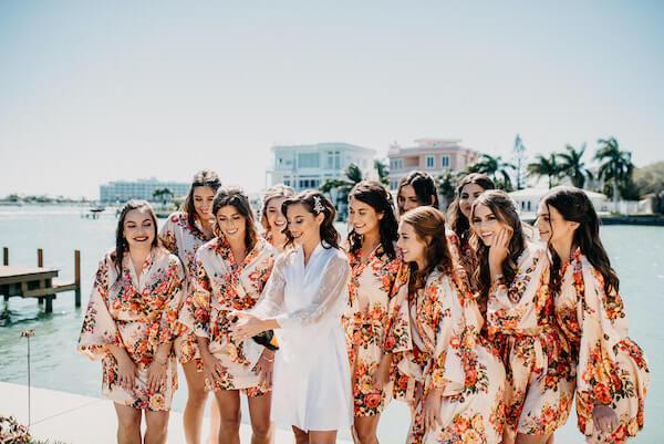 Florida wedding – Saint Petersburg Florida wedding – Saint Petersburg wedding – Greek wedding -  bride with wedding party - bride with bridal party - bride getting ready - bride popping Champagne